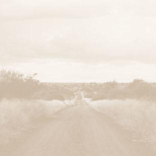 Landscape photo of a dirt road.