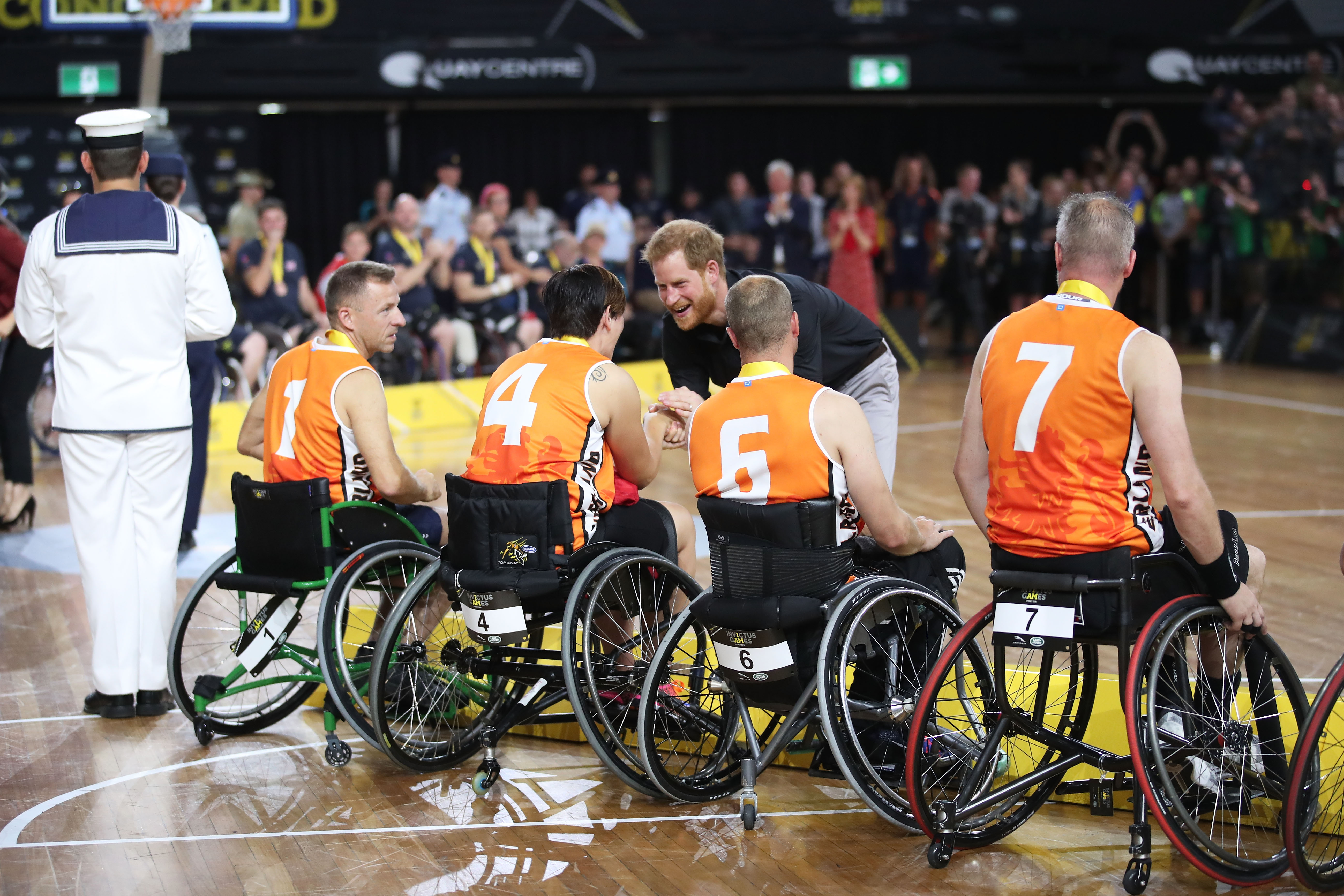 Prince Harry, Duke of Sussex congratulates the silver medallists the Netherlands after the Wheelchair Basketball gold medal match during day eight of the Invictus Games Sydney 2018 at on October 27, 2018 in Sydney, Australia.