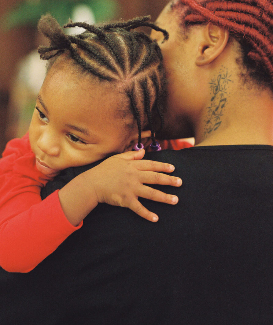 Image of woman holding a small child in an embrace.